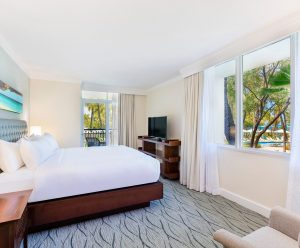 Comfortable king size bed in the Bonaire suite's spacious bedroom