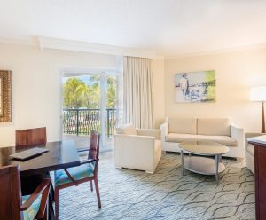 The bright, spacious living area of the Caraco Suite.