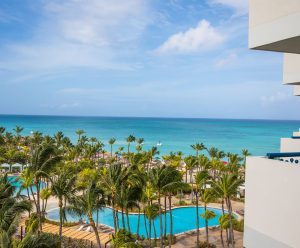 The Carribean Sea and resort pools from the balcony of an Ocean View room.